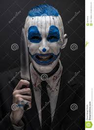 halloween background portrait terrible clown and halloween theme crazy blue clown in a black