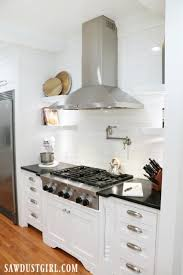 how to put filler on kitchen cabinets adding decorative legs to cooktop cabinet sawdust
