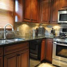 verde uba tuba granite with backsplash subway tile backsplash