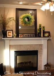 Mantel Ideas For Fireplace by A Few Key Pieces Like The Glass Jars And Driftwood Decor From