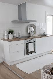 best 25 white contemporary kitchen ideas only on pinterest tiny white contemporary kitchen with wooden countertop no upper cabinets white