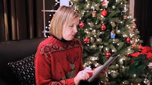 what to get an elderly woman for christmas middle aged caucasian woman opening a christmas gift at