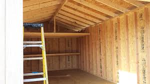 7 u2032 back wall loft with 2 u2032 back wall shelf on 12x24x11 gable garage