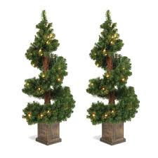 topiary trees set of 2 lighted 3 5 foot high christmas pine topiary trees in base