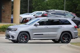 badass jeep cherokee 2018 jeep grand cherokee trackhawk spied looks ready to pounce