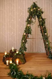 wedding arches made from trees woodland rustic wedding ceremony at hampton manor tree stumps