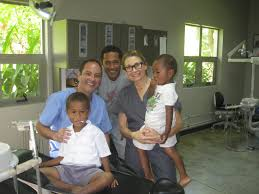 Ensuring smiles  Dr  Douglas Daniels  top left  is part of a volunteer group of dental and medical professionals travels each year to the South Pacific     La Habra Journal