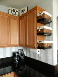 appliance baskets on top of kitchen cabinets above cabinet