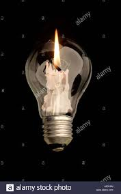 Levitating Light Bulb by Light Bulb And Candle On Black Background Digital Art Stock Photo