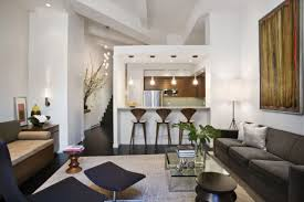 black sofas on the white off rug on the black floor inside modern