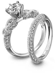 and platinum engagement ring and wedding band set by simon g