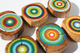 eco friendly painted tree rings on reclaimed wood wall