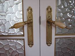 interior classic shape of door handles with granite holder and