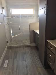dark gray 12x24 floor tile transitioning into a light white gray