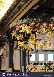 chandelier nyc golden rotating pegasus chandelier in bar room newly renovated