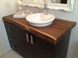 single bathroom vanity with square brown marble top and rounde