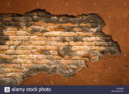 exposed brick cracked concrete wall with exposed brick stock photo 135749216