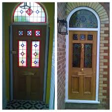 wooden front door with glass panels inside and outside of another stunning victorian front door fully