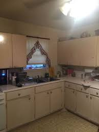 metal kitchen furniture i yucky metal kitchen cabinets is there a faux wood looking