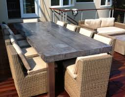 concrete and wood outdoor table make a patio space more interesting with customized concrete tables