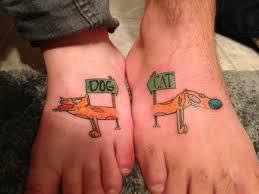 dog cat friendship tattoo on feet tattoos book 65 000 tattoos