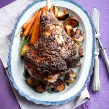 boned leg of spring lamb with herb and pine nut stuffing woman