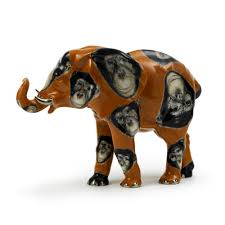 elephant figurine with monkey paintings on the body in porcelain