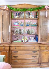 how to arrange a corner china cabinet update your china cabinet with wallpaper easy tutorial