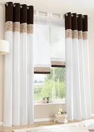 Curtains For Bedroom Windows With Designs by A Floral Printed Curtain Hangs In A Window In A Bedroom Ikea