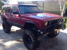 jeep cherokee xj light bar got rid of my roofrack and small light bar and put on a 50 curved