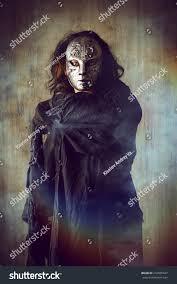 faceless mask halloween scary man iron mask black robe stock photo 272825837 shutterstock