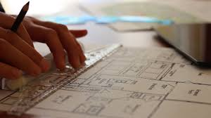 the house designer architect working on house plans using a