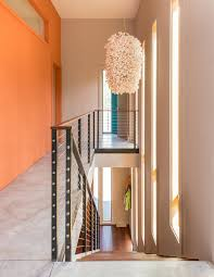 a fun cost conscious home with bright interiors and a climbing