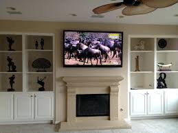 fireplace entrancing hang tv over fireplace for living ideas
