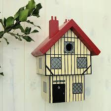 personalised tudor house bird box by lindleywood