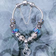 sterling pandora style bracelet images Pandora style bracelet with blue flowers and 3rd cross message jpg