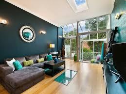 deep teal wall color modern living room decor ideas brown sofa