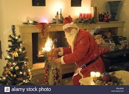 santa claus christmas presents treats bag christmas tree christmas