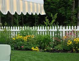 backyard with white fences and perennials different ideas of