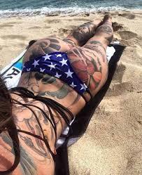 tattooed woman on the beach ideas tattoo designs