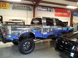 monster truck show raleigh nc matte black and matte metallic blue gmc sierra wrap for dewraps