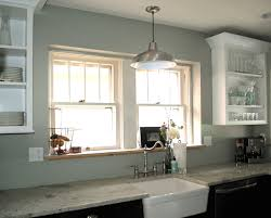 pendant lighting above kitchen sink with hanging lights for