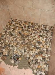 dollar floor instead of using tile in her bathroom she decided to use pebbles