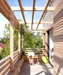 Sustainable House Design Ideas Outdoor Balcony With Wooden Bars Material Wall And Wood Balustrade
