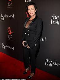 kris jenner diamond earrings kris jenner 59 displays cleavage in daring lace top at glitzy