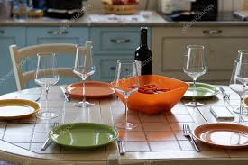 wine bottle plates wine bottle wine glasses and empty plates on the table stock