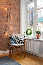 exposed brick wall lighting 20 breathtaking rooms with exposed brick brit co