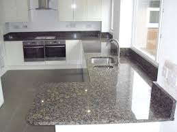 granite countertop designs with white cabinets and black