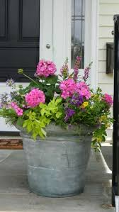 Front Porch Planter Ideas by Put This In The Front Yard Filled With Snapdragons Barrel Planter