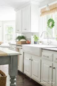 how to paint oak cabinets white kitchen faqs our painted oak cabinets two years later